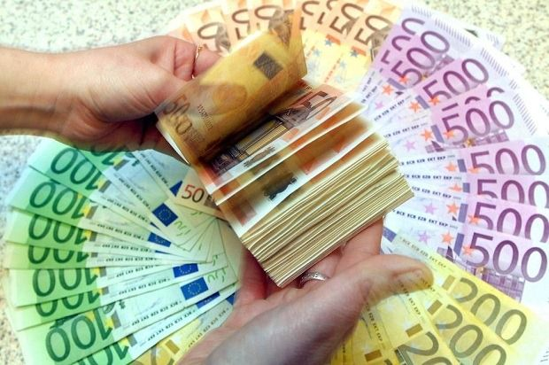 Buy some Euro. Once in Europe, ATM's will give you the best exchange rate. But it always helps to have €100+ in your pocket. You never know if the ATM machine at the airport is working and you'll still need to get to town, where there are many, many ATM options. Check your local bank, buy some before you come, and avoid the airport exchange booths as they usually have the worst rates and the highest surcharges.