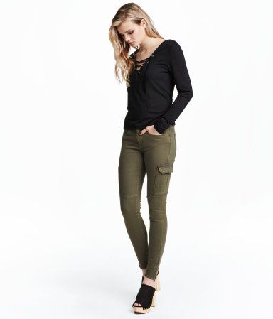 Low-rise cargo pants in stretch twill. Front and back pockets, leg pockets with flap, and slim legs with zip at hems.