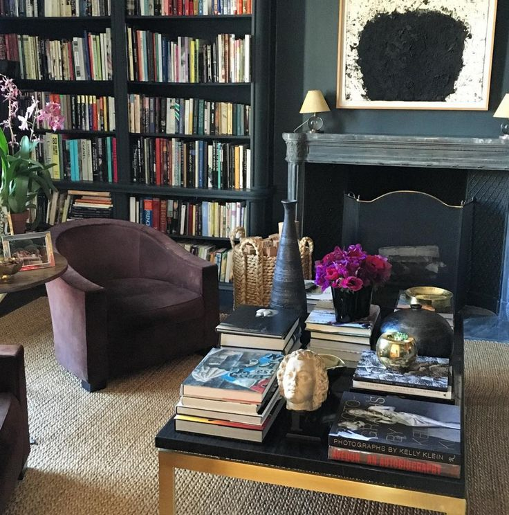 Chic dark walled home library floor to ceiling bookshelves