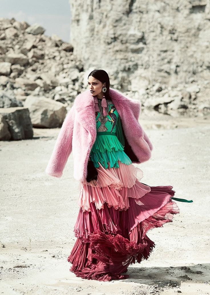 Looking pretty in pink, Lizzy Salt poses in J. Crew faux fur coat and Gucci tiered ruffle dress