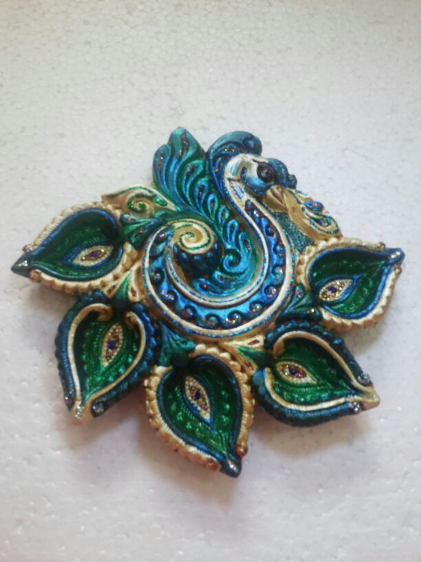 Buy #handpainted small #peacock shaped #diya online from #craftshopsindia
