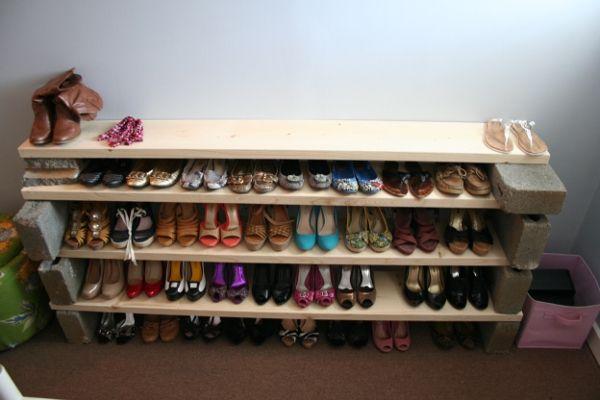 Cinder blocks + 2 x 4's make a super simple shoe rack!!