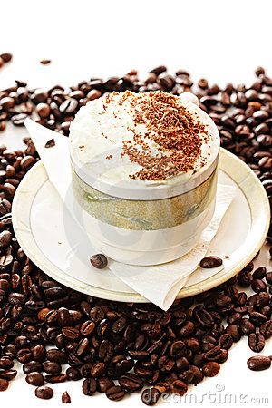 Cup of cappuccino coffee on beans