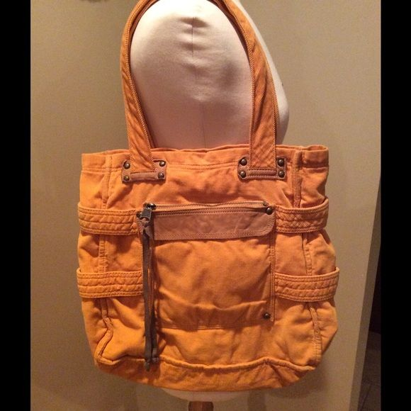 ⬇️REDUCED⬇️ Mustard Tote, NWOT Mustard color tote with 1 snap closure. Inside has 1 big zippered pocket and 2 other open pockets. Shell is 100% cotton, decoration on outside is 100% leather. GAP Bags Totes