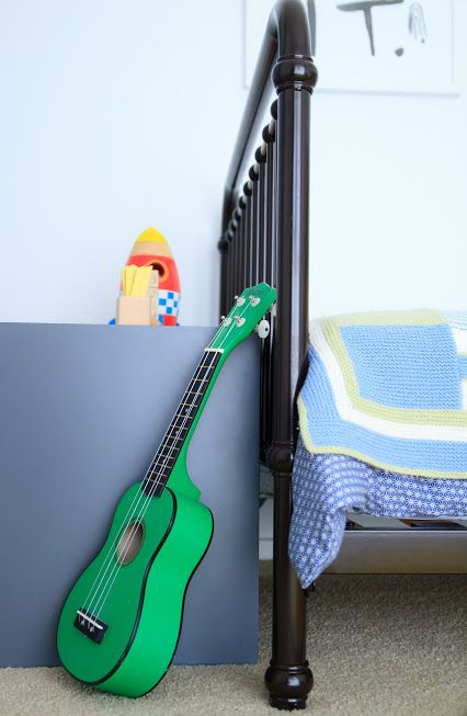 A little bit of rockstar with this green guitar for this boysroom.  Incy Interiors beautiful chocolate Oscar bed, muuto stacking shelves, handmade blanket give a homely feel.  Styling by Little Nook Interiors