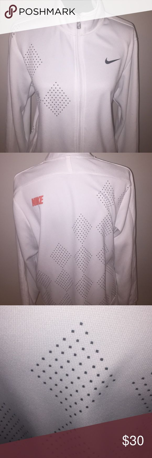 Nike zip up jacket Nike dri fit zip up jacket in white with gray diamond shape pattern on right from and the back. The orange Nike on the back is on the left upper near shoulder - has pockets- uni sex men's medium would fit women's large- in excellent condition Nike Jackets & Coats Performance Jackets