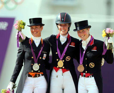 Charlotte Dujardin celebrates her gold medal win in the Equestrian Dressage Individual Grand Prix.