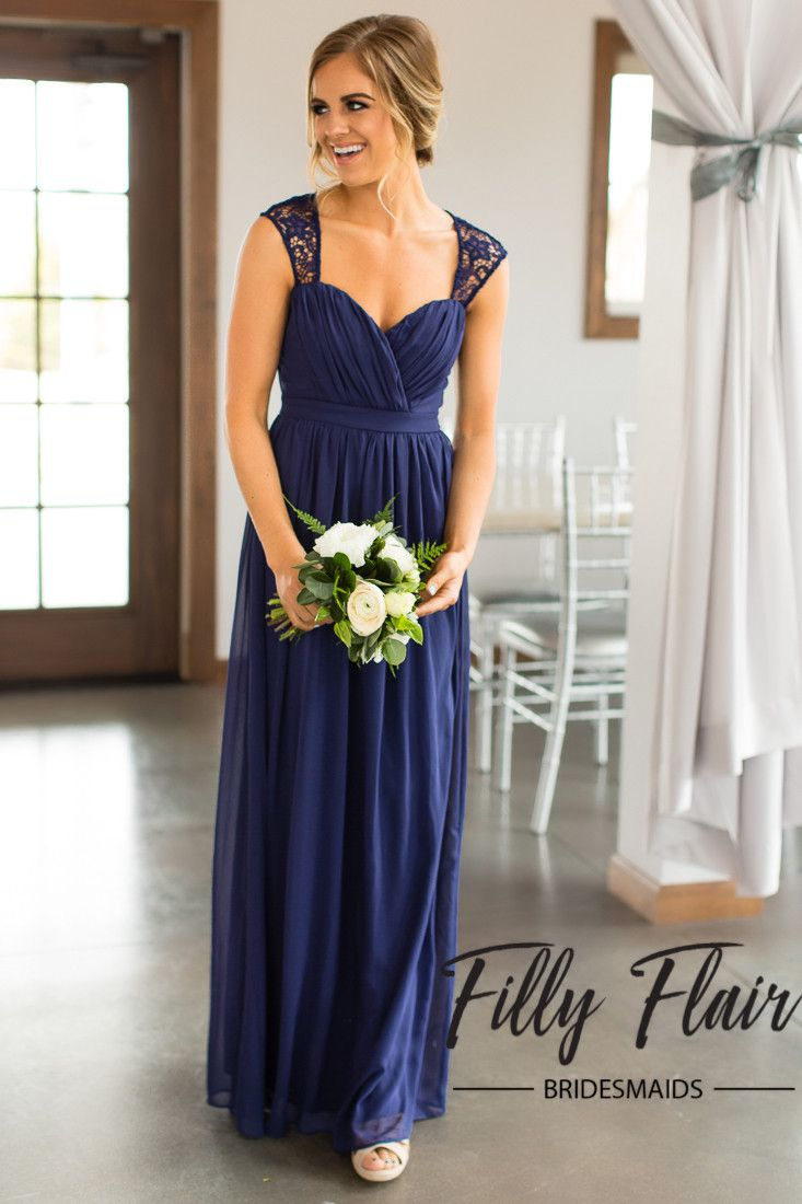Stunningly beautiful is the perfect way to describe our Daphne Bridesmaid Dress. This timeless floor length gown is the perfect navy bridesmaid dress for any formal wedding. It's fully lined skirt fea
