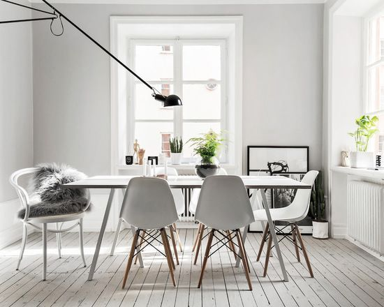 White modern dining room featuring the eiffel dining chair