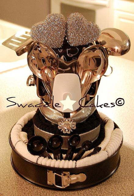 Cookies & Cream Kitchen Towel Cake    *7 stainless steel kitchen tools  *4 kitchen towels  *2 dish towels  *2 heart sponges  *2 spatulas  *1 glamorous ring  *1 heart sponge tray  *1 potholder  *1 oven mitt   *1 set of KitchenAid measuring spoons  *1 springform cake pan  *1 utensil caddy  - bjl