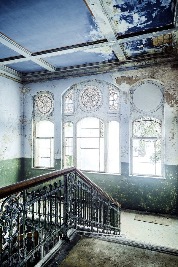 Ornate stair railing and beautiful windows in abandoned building – Marisa Marko