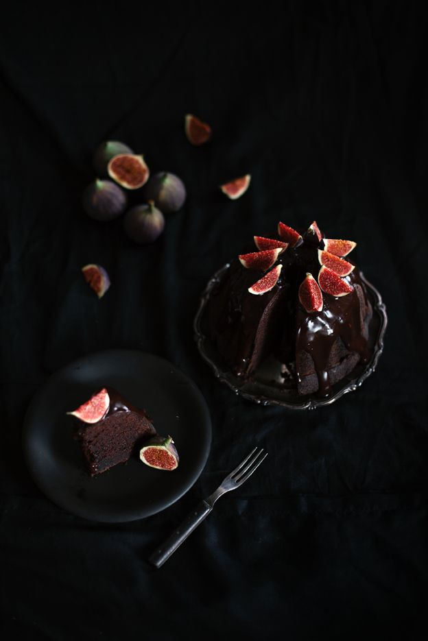 """Chocolate bundt cake with chocolate ganache glaze"" from ""Call me cupcake."" Click through for the recipe and for more stunning photos of this lovely cake with the fig accents."