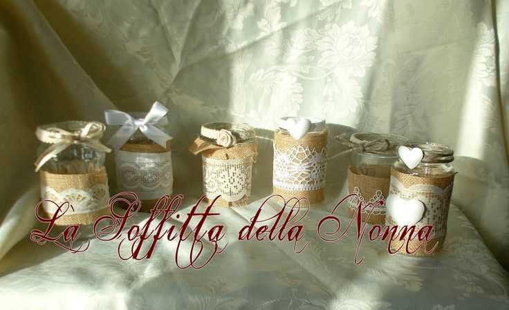 Glass jars covered with burlap ribbons and lace