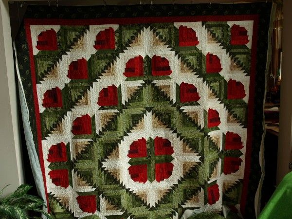 Check out this variation of a log cabin quilt – pretty neat, isn't it? Great work, Caron!