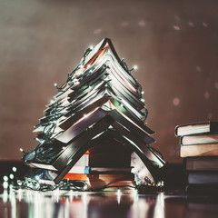 Christmas tree with lights made with books