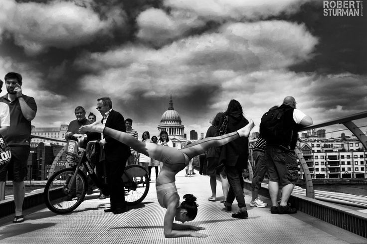 Yoga In London (Gorgeous Slideshow) St. Paul's at Millenium Bridge ~ Pictured: Naomi Absalom  Loved and pinned by www.downdogboutique.com