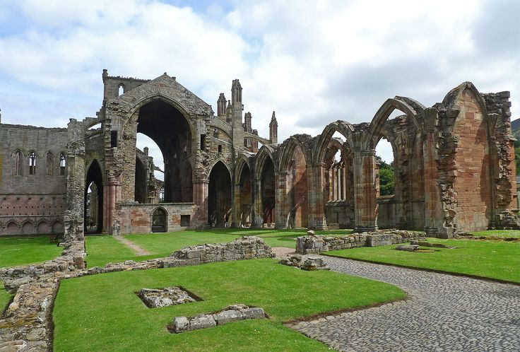 Melrose Abbey is a magnificent ruin on a grand scale with lavishly decorated masonry.