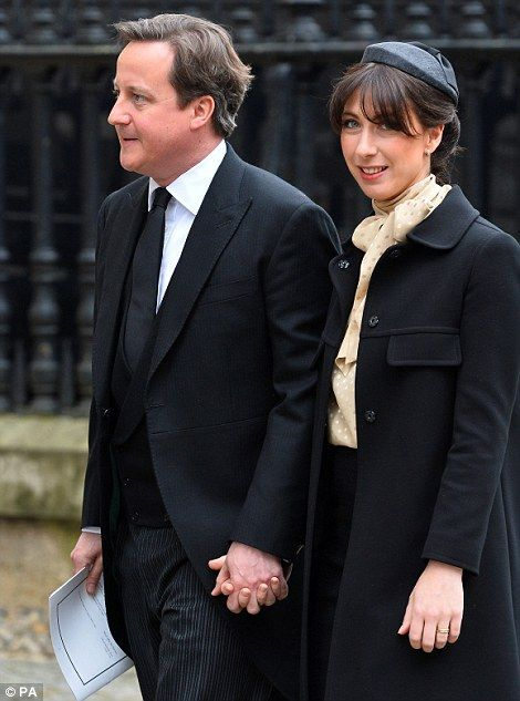 Prime Minister David Cameron & wife Samantha    Baroness Thatcher's funeral, the first female UK prime minister, was conducted along the same lines as those of Diana, Princess of Wales, and the Queen Mother.    She was accorded a ceremonial funeral with military honours. It began at 11:00 BST on Wednesday, 17 April, at St Paul's Cathedral in London.    It was the first time the Queen had attended the funeral of a British prime minister since that of Sir Winston Churchill in 1965.