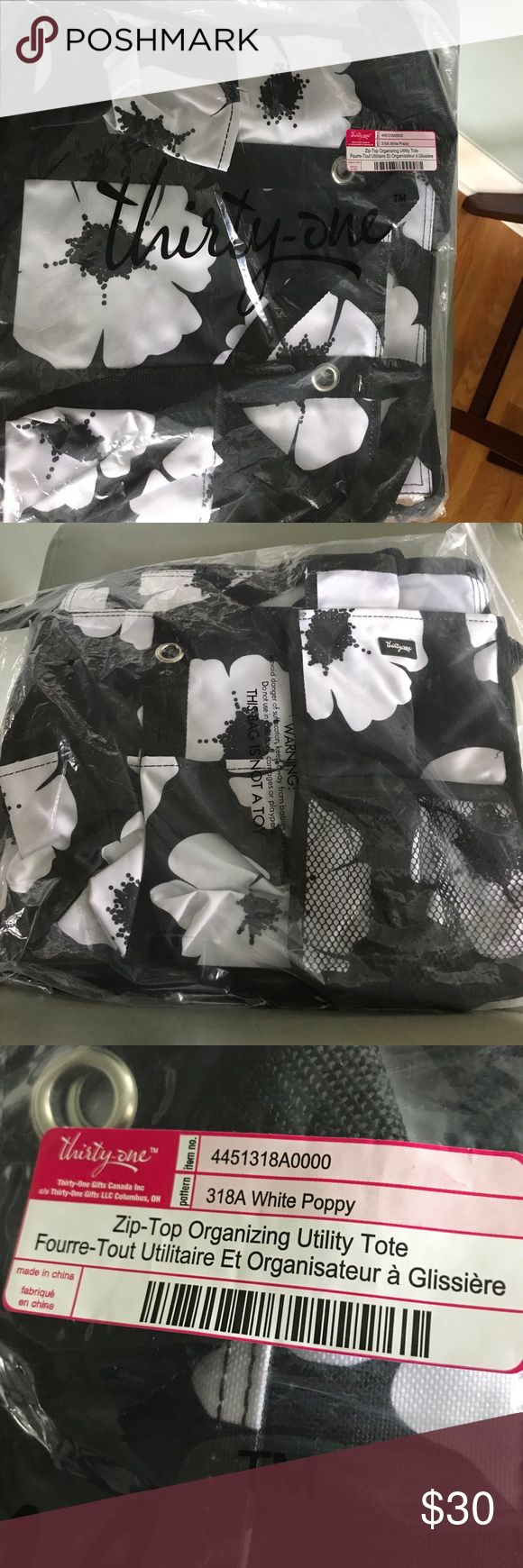 NWT Thirty-One Zip top Organizing Utility Tote Retired Hard to find White poppy Tote Zip top, 7 exterior Pockets NWT 10.75H 14.5 L Thirty-One Bags Totes