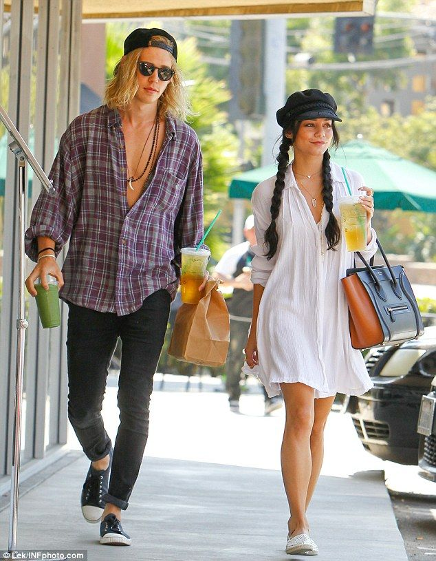 Handsome: Austin Butler took the plunge in a tartan shirt, half-buttoned, alongside his li...