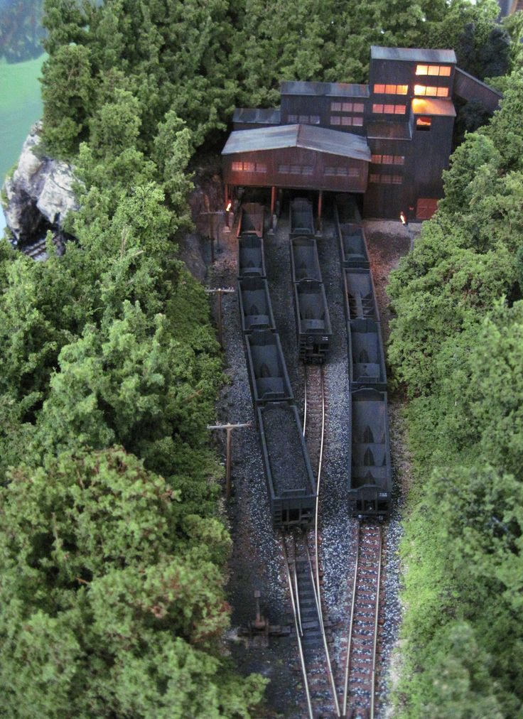 https://flic.kr/p/bVDgHX | N scale Tidewater Junction | N scale Tide water Junction layout. This layout is a Norfolk & Western flavored layout. It features a coal mine and a coal facility down at the harbor. Two trains can run on the layout one on a high line, and one on a lower line. This layout is for sale in June as well...