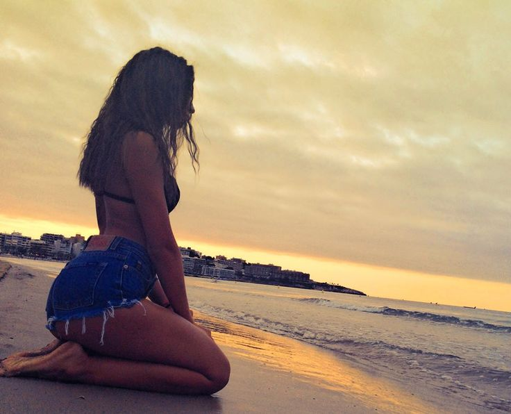 Girl in jeans shorts on beach-------------beautiful evening and sunset