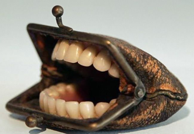 Teeth in coin purse concept: Don't spend money? #surrealism