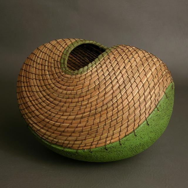 'Green boat' (basket) by LA-based Costa Rican ceramic artist Hannie Goldgewicht. Pine needles, clay. via the artist's site