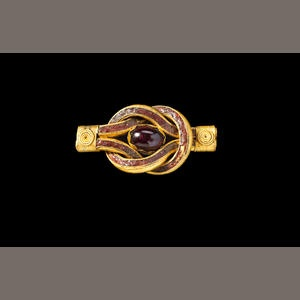 A Hellenistic gold and garnet Herakles knot, Circa 3rd Century B.C. Probably formed part of a diadem or bracelet