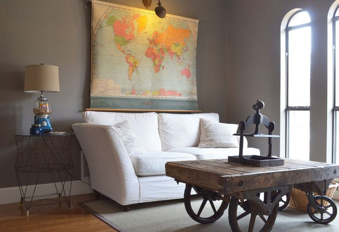 love the touches in this house but especially the vintage school world map hanging above the couch! Brilliant!
