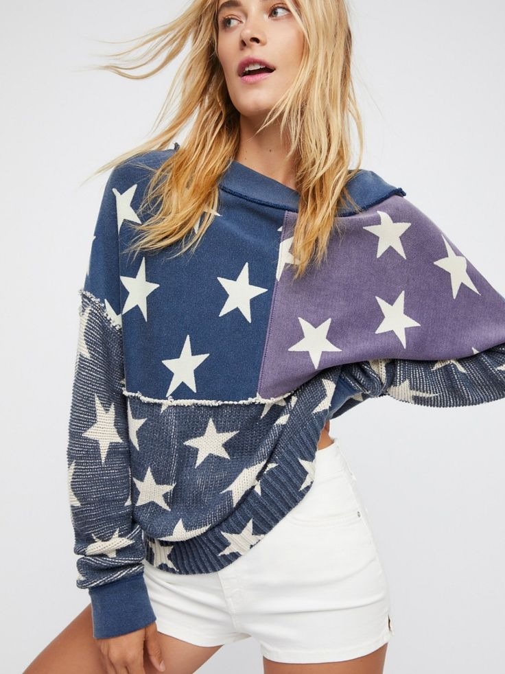 Stars and Stripes Pullover | Patriotic pullover featuring an allover star print and a red zipper on the back.  * Washed fabric   * Pieced with contrast knit along the bottom and sleeves   * Exposed seam detailing   * Boxy fit