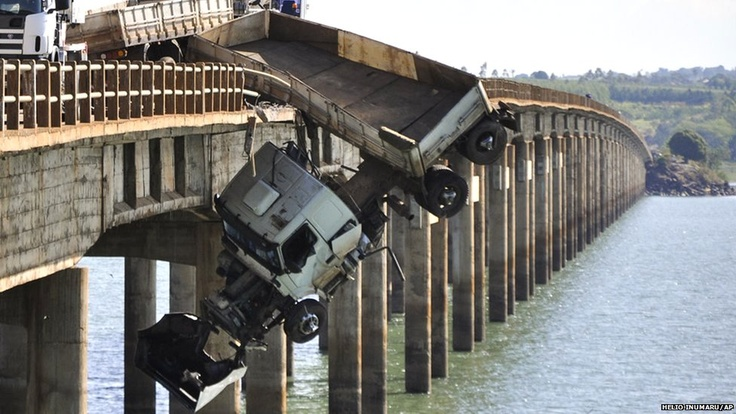 A lorry driver in southern Brazil had a miraculous escape when his vehicle skidded over the guard rail as he crossed a bridge linking the states of Sao Paulo and Parana.