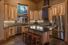 modern-kitchen hickory cabinets glass subway tile backsplash hardwood flooring