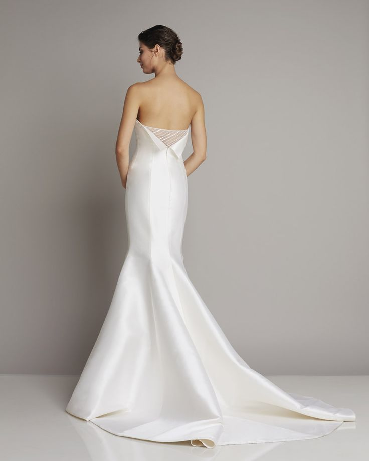 Slim strapless wedding dress of silk in the style mermaid with an extravagant back Detail of Giuseppe Papini