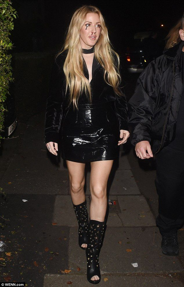 Peep toe studded boots and a black choker added to the look, while the star wore her blonde hair loose around her shoulders.