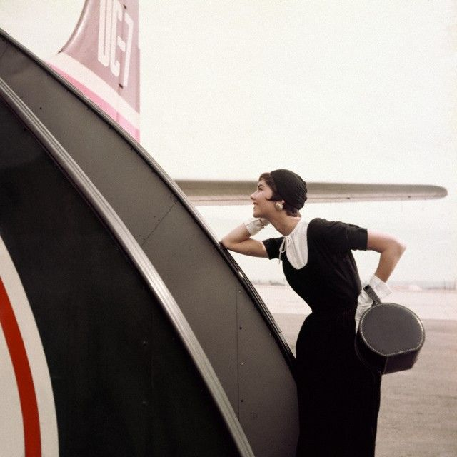 white dickey & gloves on the plane- Condé  Nast Archives, 1954