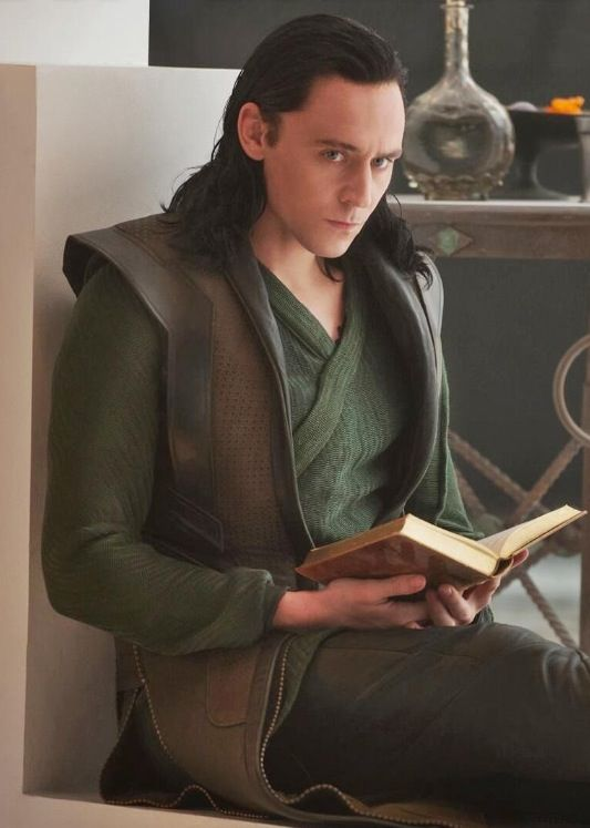 LOOOOOOKIIII! Can I read with you?! Loki: fine Me: Yay! *grabs book and curls next to Loki* Loki: what are you doing? Me: .........................reading...................