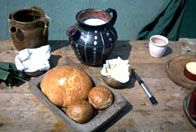 A image of a a selection of bread, butter and jug of milk- Viking food