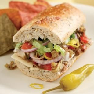 Beat the summer lunchtime blues with this healthy Italian Vegetable Hoagie. This delightfully easy, and somewhat messy, sandwich recipe packs a punch with sweet balsamic vinegar, artichoke hearts, red onion, provolone cheese and zesty pepperoncini. Give this healthy sandwich recipe a try for dinner or lunch. @EatingWell