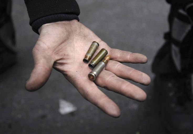 A man shows a bullet and empty casings amid the clashes in Kiev on Thursday....