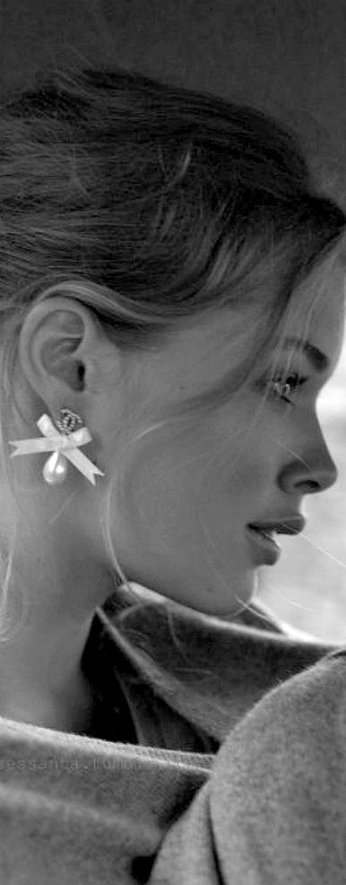 Chanel earrings would complete a chic wedding day look and could be worn again and again.