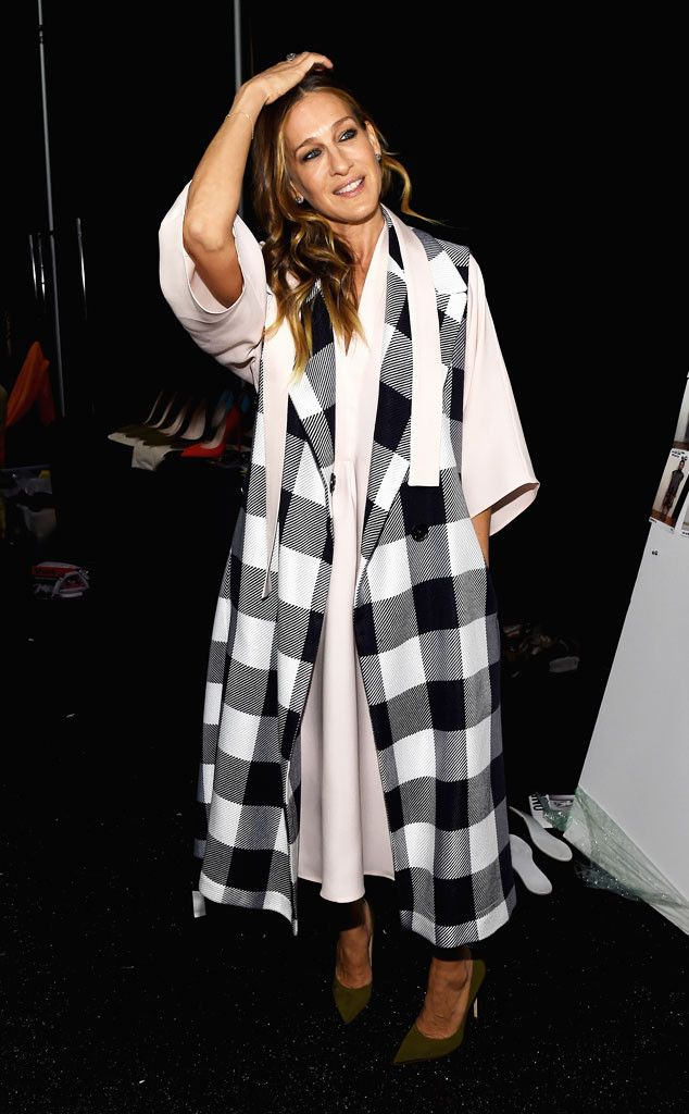 Sarah Jessica Parker from Stars at New York Fashion Week Fall 2015 SJP has arrived! The stylish star opts for a long checkered vest and a loose frock backstage at the Tome show.