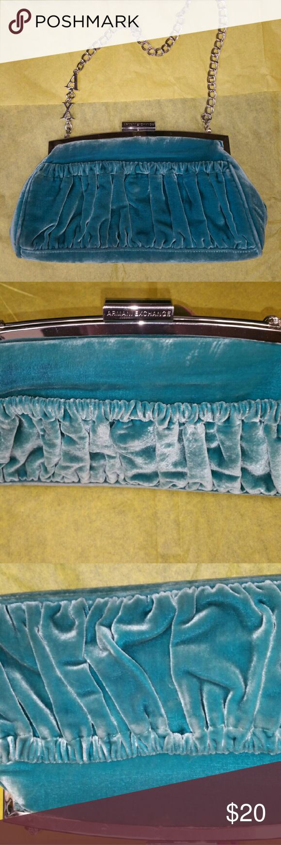 Armani Exchange purse Adorable velvet teal color mini purse good condition other then small imperfection see  4th pic. Not very noticable Armani Exchange Accessories