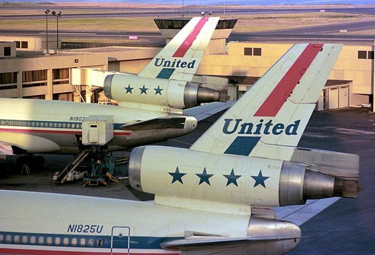 "United Airlines McDonnell Douglas DC-10-10 N1825U and McDonnell Douglas DC-10-10 N1802U at Boston-Logan, still waiting to be upgraded to the ""Tulip"" livery, circa September 1977. (Photo: Rudy Chiarello)"