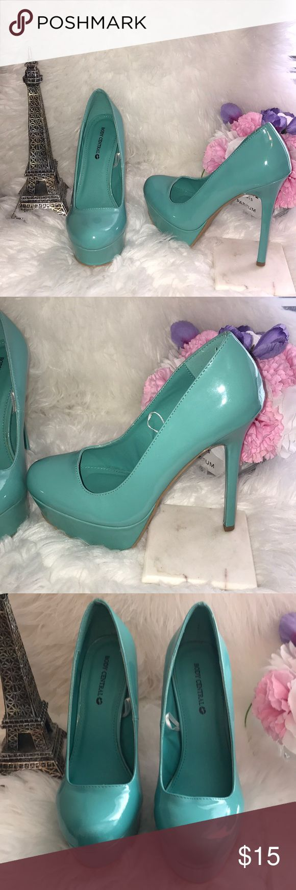 Body Central Pump Teal heels  Like new condition only worn ones for modeling purposes, beautiful super comfortable Teal Color heels, size 7.5 & 51/2 tall heels with a platform 1 1/2 for comfort. Body Central Shoes Heels