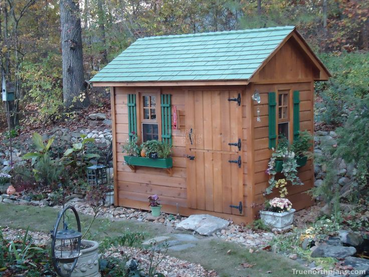 This 6' x 9' Palmerston garden shed plan features cedar siding, antique style flower boxes and Dutch doors