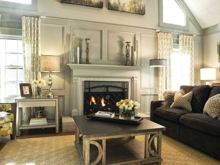 gray living room, transitional style, coffee table, mercury glass acccents. two story windows.