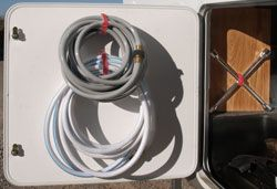 Hang coiled hoses from nylon velcro straps.