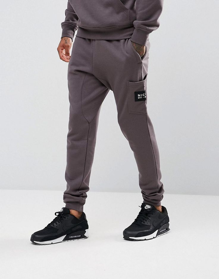 Get this Nicce London's joggers now! Click for more details. Worldwide shipping. Nicce London Skinny Joggers With Patch Logo - Grey: Joggers by Nicce London, Soft-touch sweat fabric, Drawstring waistband, With metal tips and eyelets, Side pockets, Single back pocket, Nicce London logo patch, Fitted cuffs, Regular fit - true to size, Machine wash, 100% Polyester, Our model wears a size Medium and is 183cm/6'0 tall. Clean, contemporary design is at the forefront of Nicce London's vision…