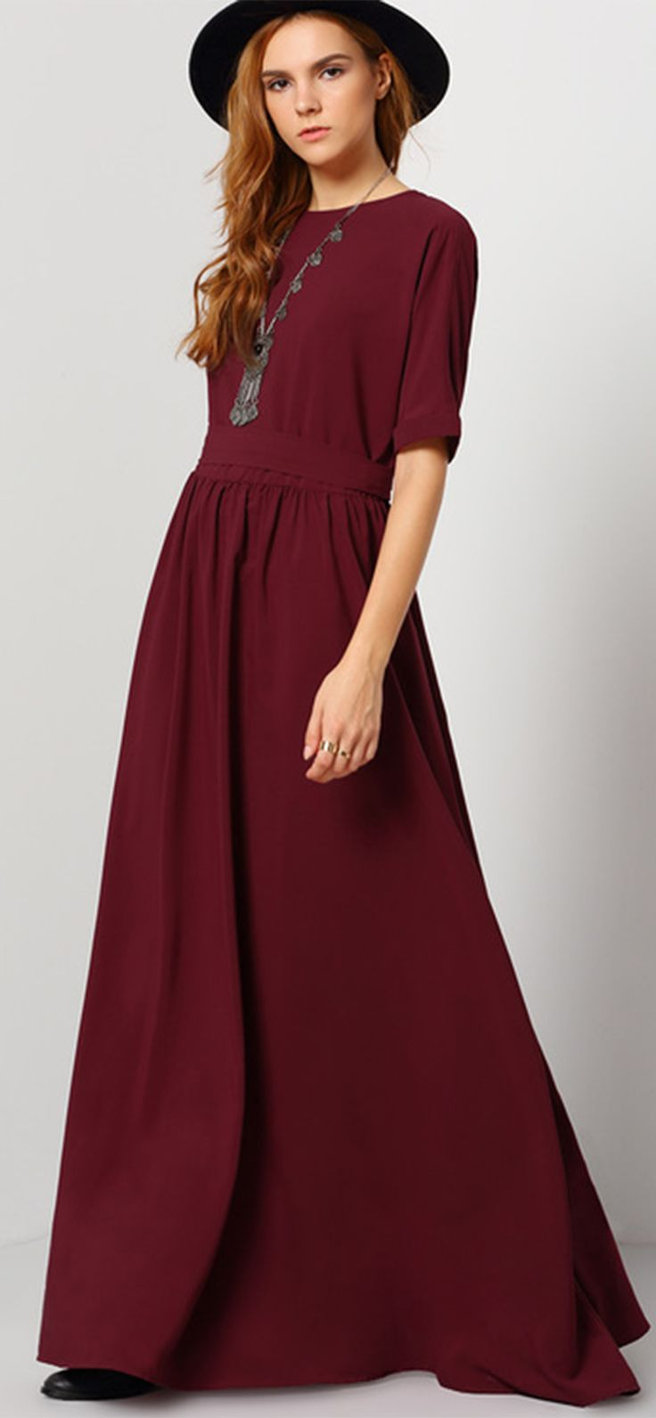 Slip into a volume of sophistication with this burgundy maxi dress. A classic round neck and folded elbow length sleeves is crafted on its upper bodice, which is then cinched with a runched waistline. Finishing is design is its flowy and full bias skirt.